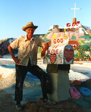 Leonard Knight next to his Salvation Mountain.