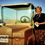 Petre Melvin and her golf cart in Bombay Beach.