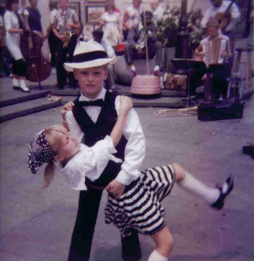 Boy dancer dipping his female partner