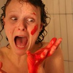 Bloody, naked woman in shower screams