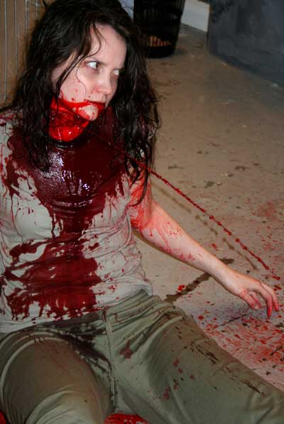 Woman covered in blood since her throat has been slit