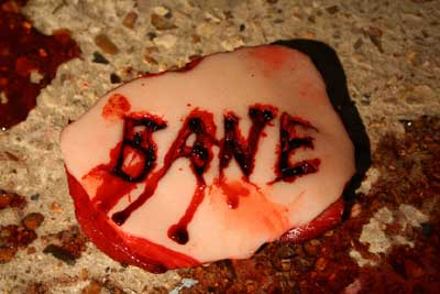 Bane logo cut into flesh