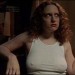 Georgia (Jordana Berliner) smokes a cigarette while wearing a white t-shirt