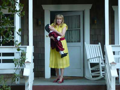 Actress Lynn Lowry carries a disturbing doll in Basement Jack
