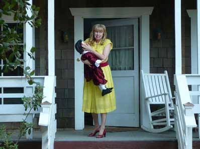 Actress Lynn Lowry carries a disturbing doll in Basement Jack