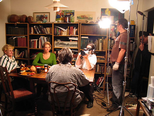 Waylon Bacon films a scene around a dinner table