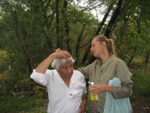 Director Rebecca Conroy preps Kumar Pallana for a scene.
