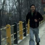 Dilawar runs across the bridge