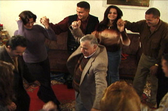 Iraqis dance in their living room