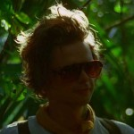 Young man wearing sunglasses in the jungle
