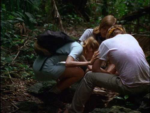 Three young adults stop to do drugs in the jungle
