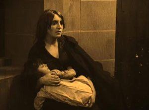 Homeless woman cradling her son