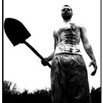 An amnesia victim covered in blood holds a shovel