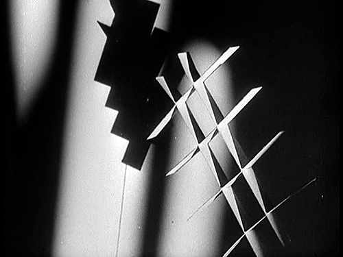 An abstract shape casting a shadow