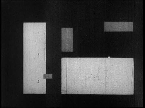 Abstract film still featuring black and white rectangles of various shapes