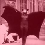 Woman in bat costume stretches her wings