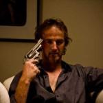 Man points gun at his own head
