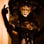 Woman wearing a mask and a bizarre costume