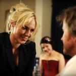Beautiful blonde woman stares at grungy man