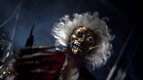 Crazy gold mask with fangs and fright wig