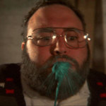 Bearded man spits out green goo