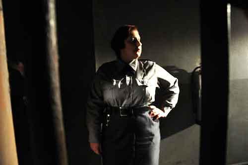 Burly female prison guard
