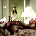 Young girl in pajamas looks over her mother's bloody corpse