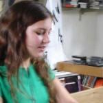 Teenage girl in green t-shirt in music store