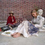 Wren and Lilie Bytheway-Hoy as two hippie teenage girls creating art outside