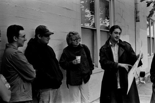 Director Waylon Bacon gives instructions to film extras