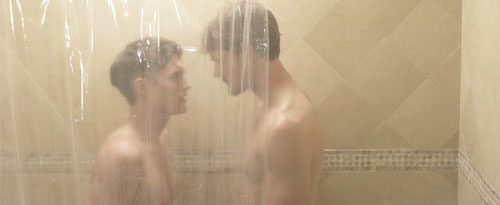 Two grown men take a shower together