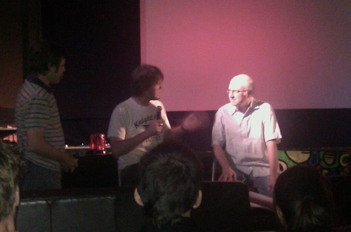 Filmmaker Jeff Krulik sits on a stage with a man named Jay