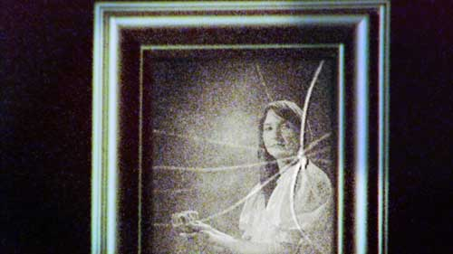 Shattered old time photograph of woman