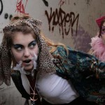 Two teenage girls run around wearing outlandish costumes