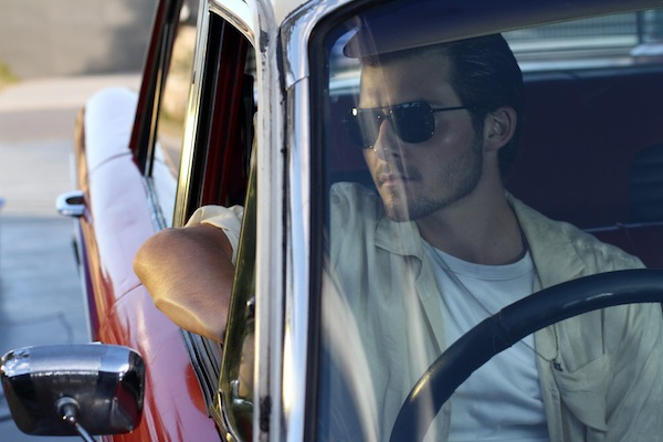 Actor Liam Graham as Max Woods sitting in a car