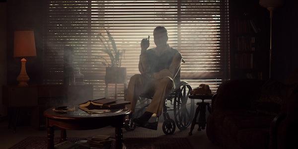 Actor Richard Mellick as Edmond Bloom sitting in a wheelchair