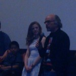 Clint Howard address the audience after a movie screening while Ashley Bell looks on
