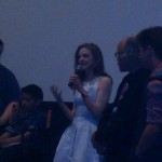 Actress Ashley Bell address the audience after a movie screening