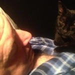 Filmmaker Jeff Krulik is sleeping while his black cat Iggy Smalls lays on his chest.