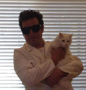 Filmmaker Mike Davis poses with his white cat named The Girl