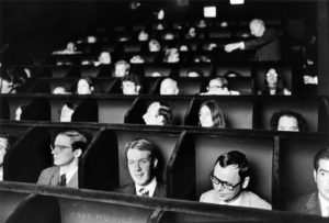 Audience watches a movie at the original Invisible Cinema theater of the Anthology Film Archives