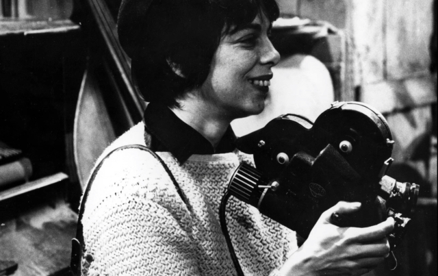 Filmmaker Shirley Clarke holding a 16mm camera