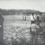 Jonas Mekas directs a scene from his film Guns of the Trees while his crew works a camera dolly