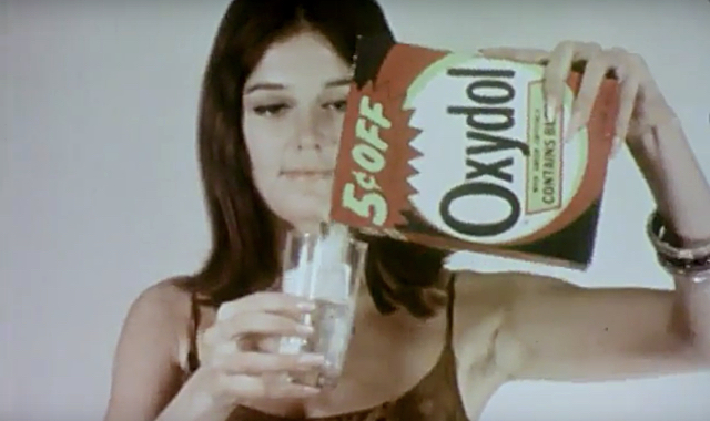 Gloria Steinem pours laundry detergent into a glass in the short film The Pop Show by Fred Mogubgub